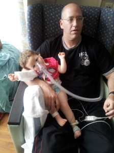 Hanging out with daddy while getting a breathing treatment