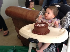 Starting to eat her cake