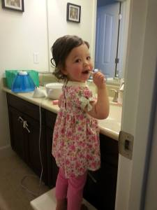 Big girl brushing her teeth