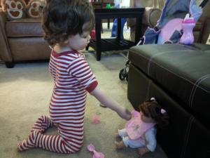 Feeding her dolly