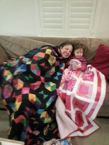 Snuggled under our quilts