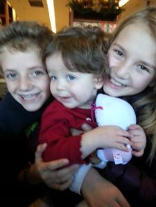 With her cousins Siena and Tyler