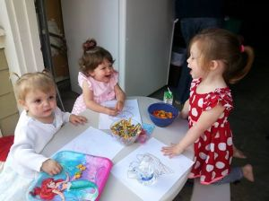 Chatting with her friends at a birthday party