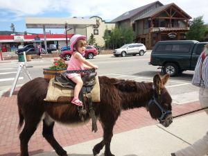 Riding a donkey in downtown Frisco