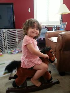 Riding her horse.