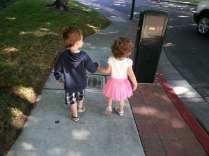 Holding hands with her friend Kolton.