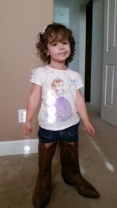 Trying on mommy's boots