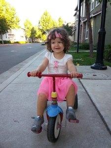 Riding her bike around the neighborhood