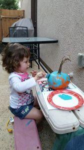 Painting a pumpkin teal