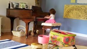 Playing piano at Maureen's