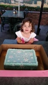 Eliza with her delicious birthday cake!