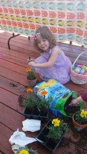 Potting her plant at the Easter party
